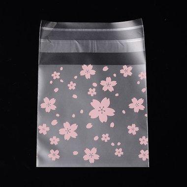 Cellofaan zakjes met plakstrip bloemetjes roze op mat zakje